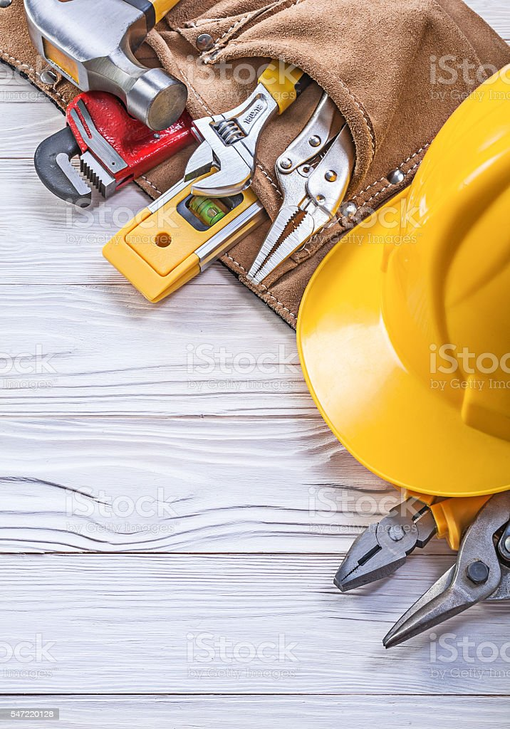 Leather construction belt hard hat on wooden board maintenance c stock photo