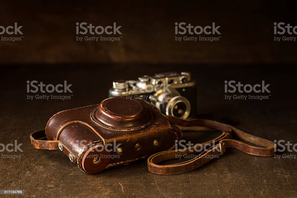 Leather cover and old 35mm camera stock photo
