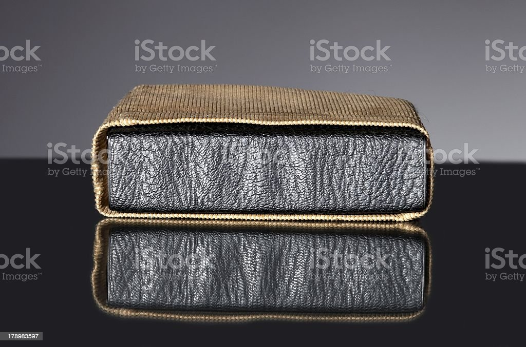 Leather cover of old book in vintage bag royalty-free stock photo