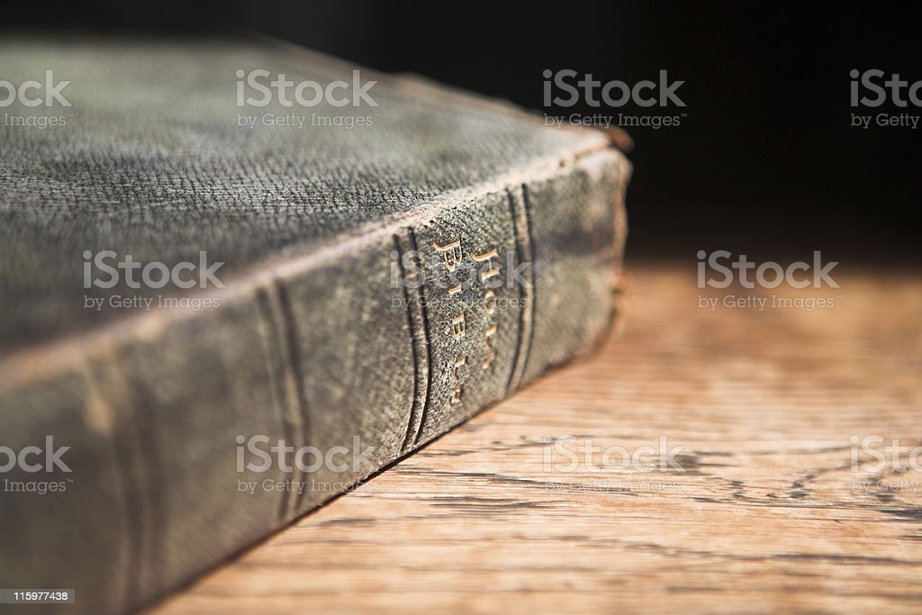 Leather covered bible lying on a table stock photo