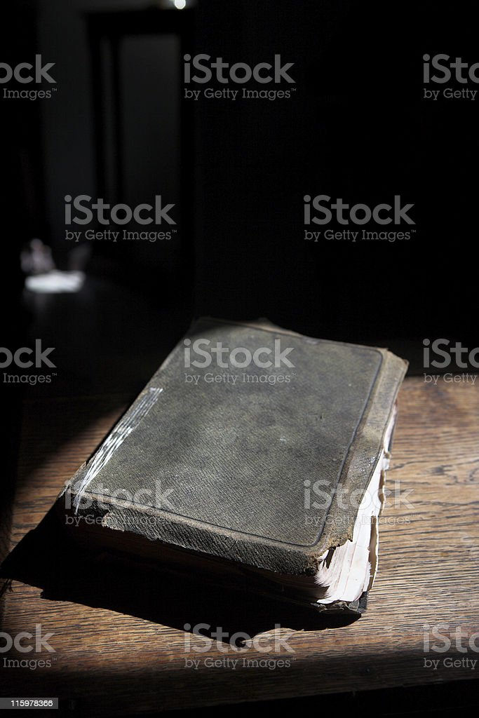Leather covered bible lying on a table royalty-free stock photo