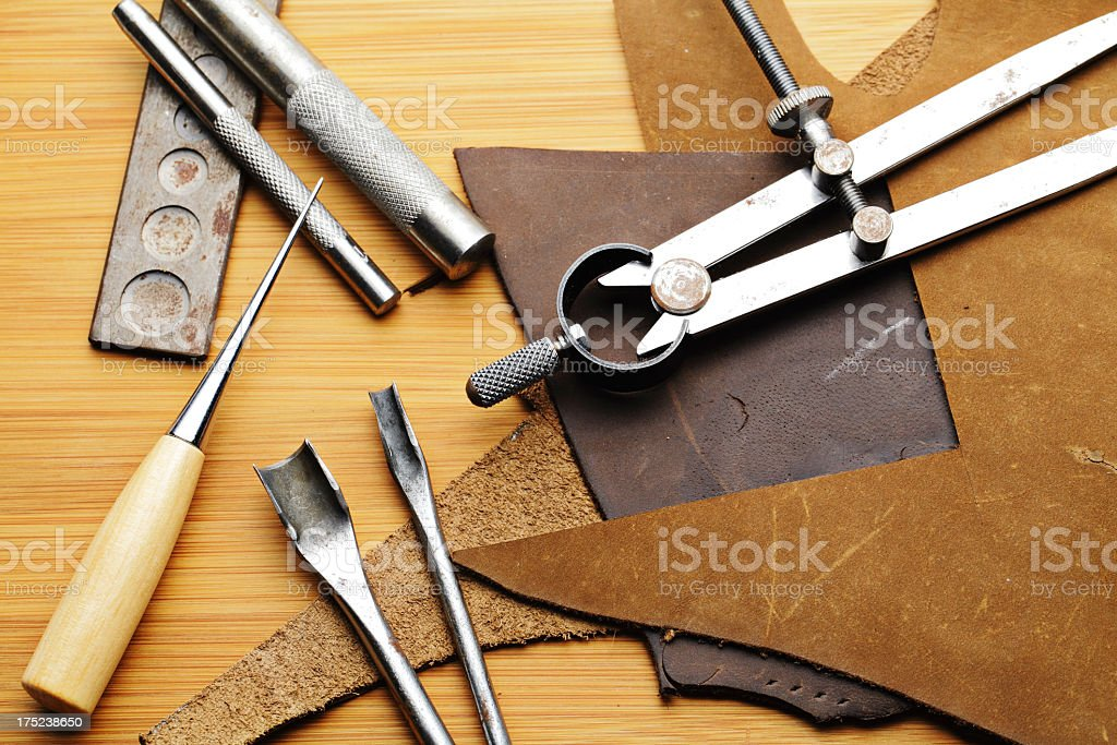 Leather craft tool on the wooden table stock photo