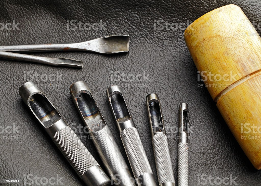 Leather craft with circle punch stock photo
