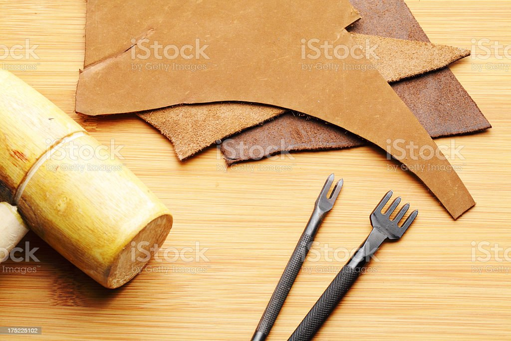 Leather craft with mallet royalty-free stock photo