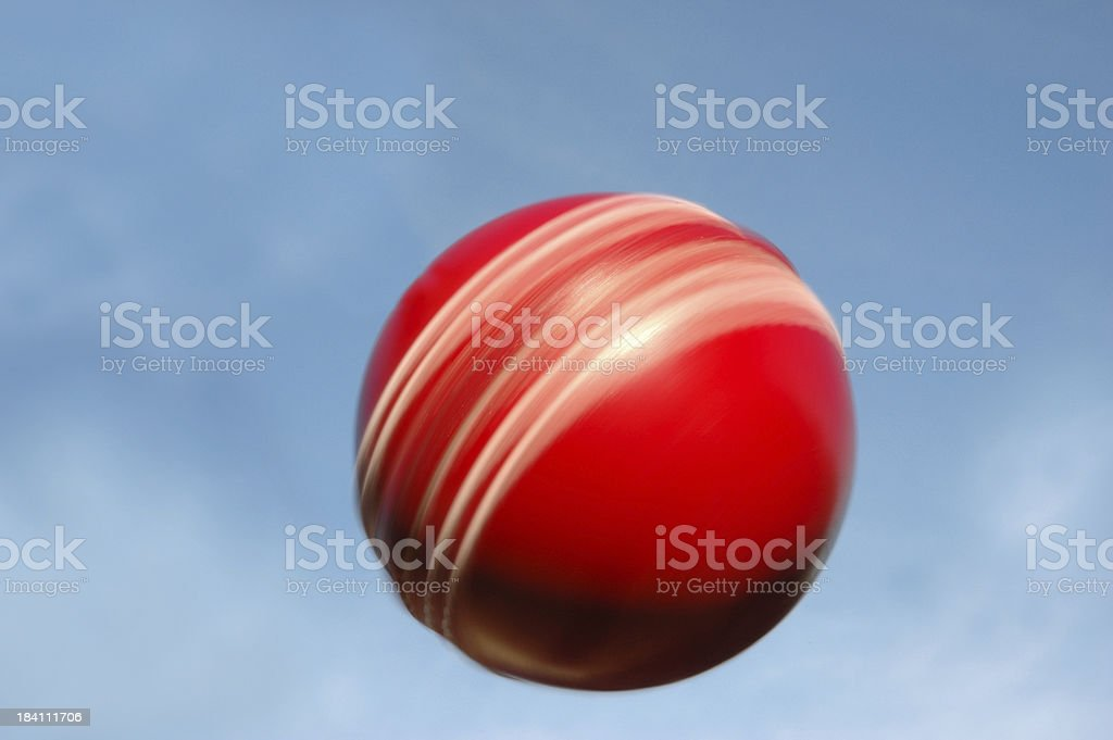 Leather Cricket Ball spinning against sky stock photo