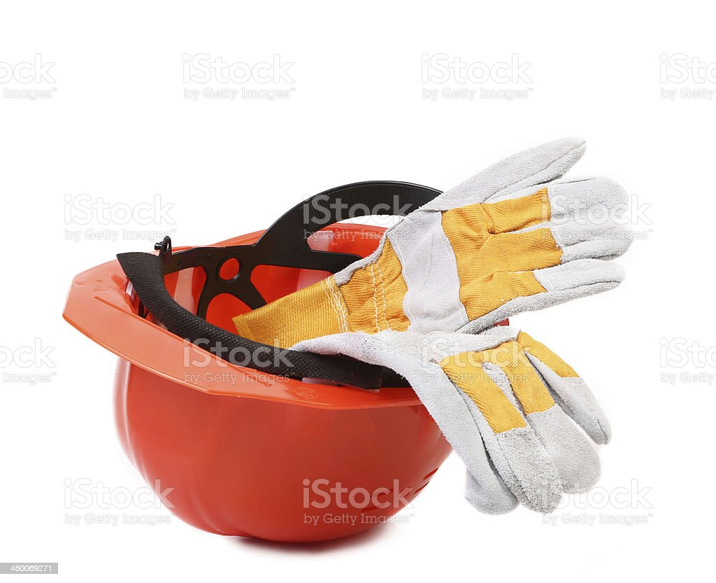 Leather gloves in hard hat. royalty-free stock photo