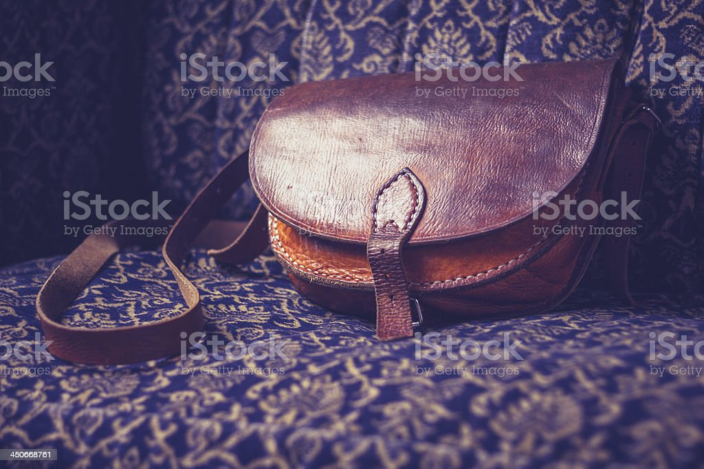 Leather handbag on vintage sofa stock photo