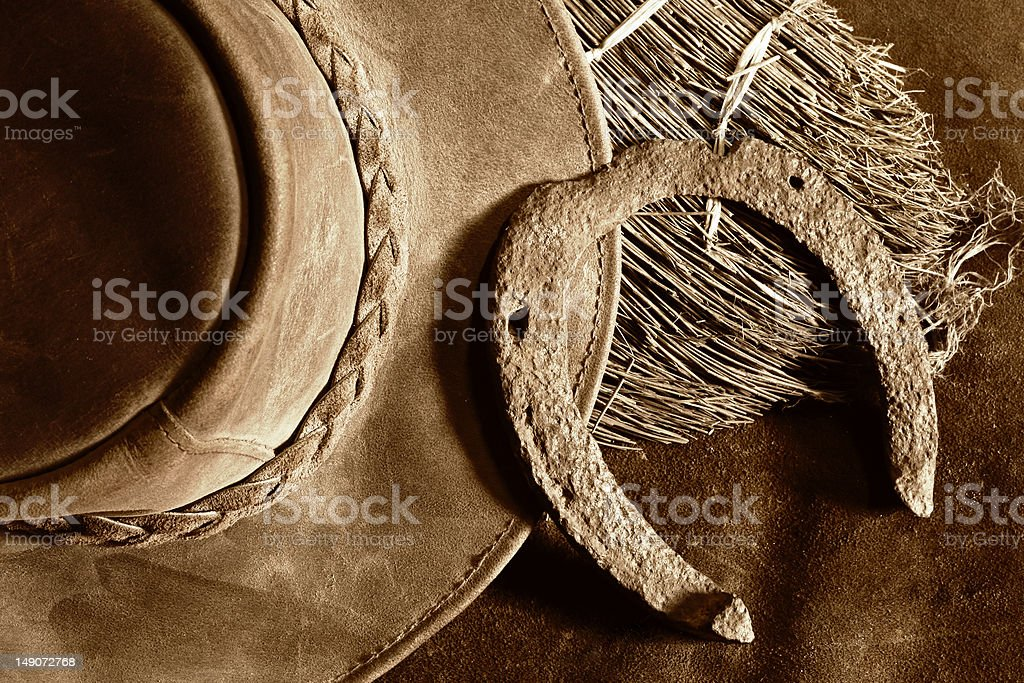 leather hat and old horseshoe royalty-free stock photo