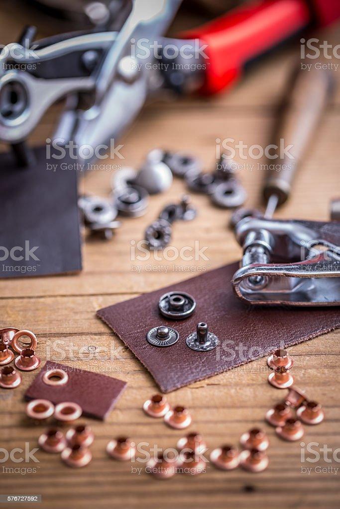 Leather hole punch stock photo
