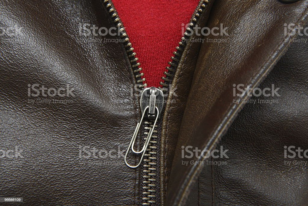 leather jacket with paper-clip zipper tag stock photo