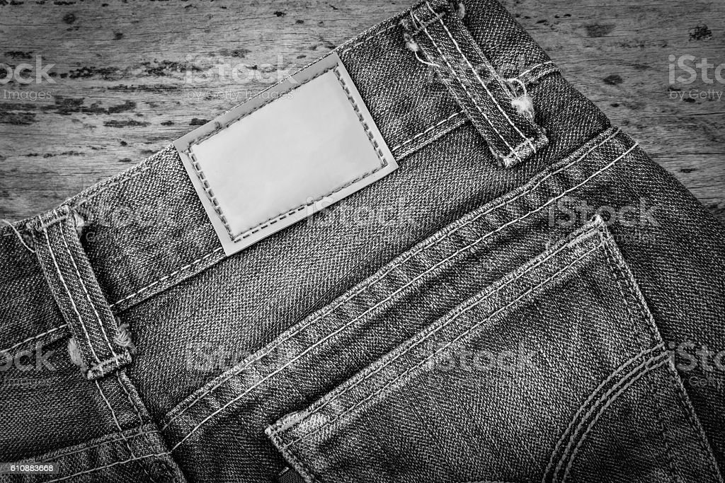 Leather jeans label sewed on blue jeans. stock photo