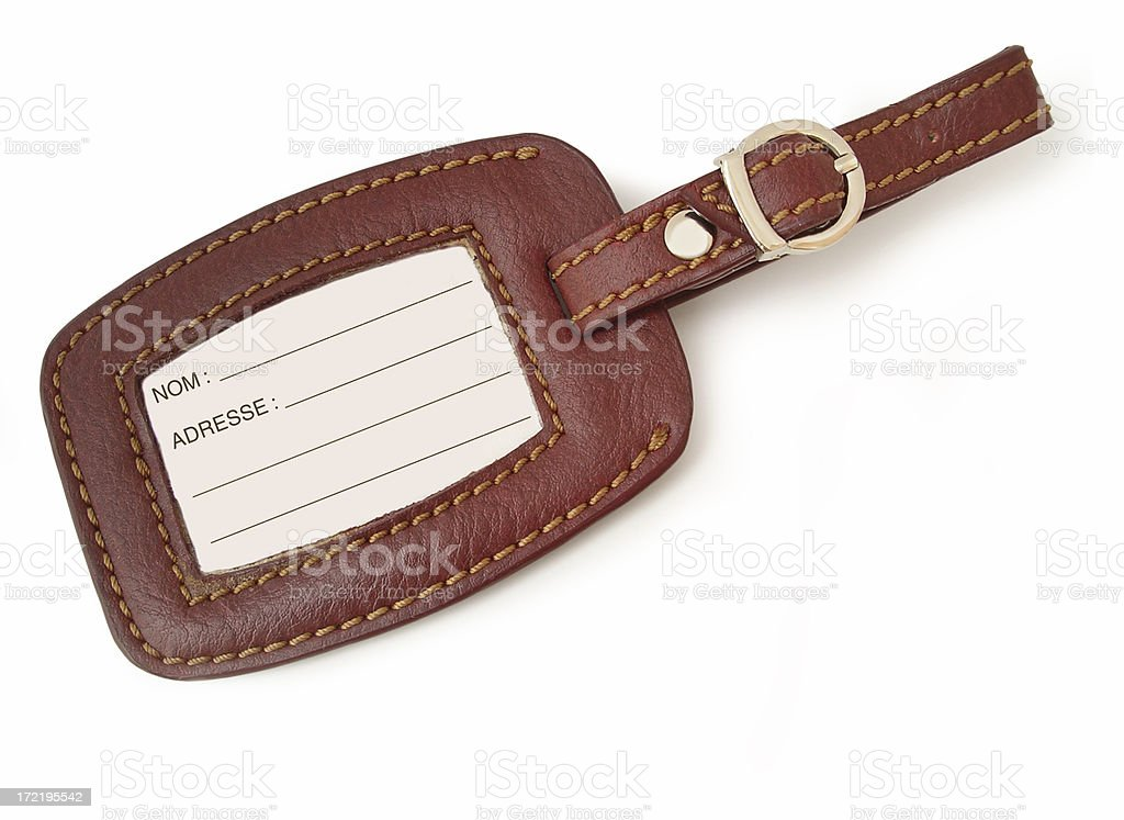 Leather luggage tag (french version) royalty-free stock photo