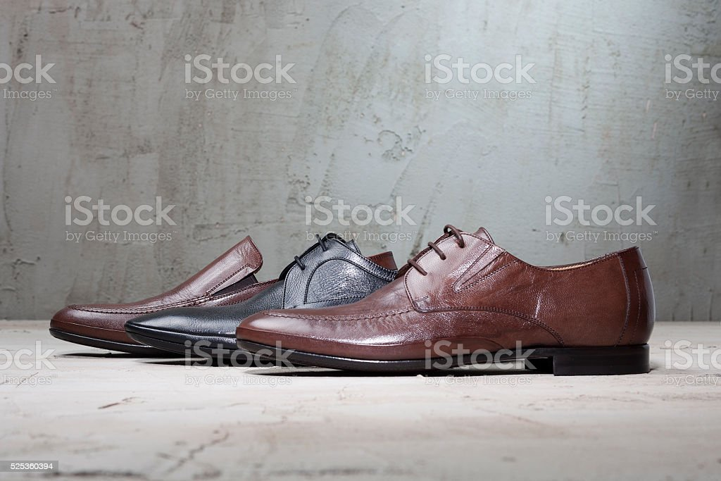 Leather Men Shoes on Concrete Ground stock photo