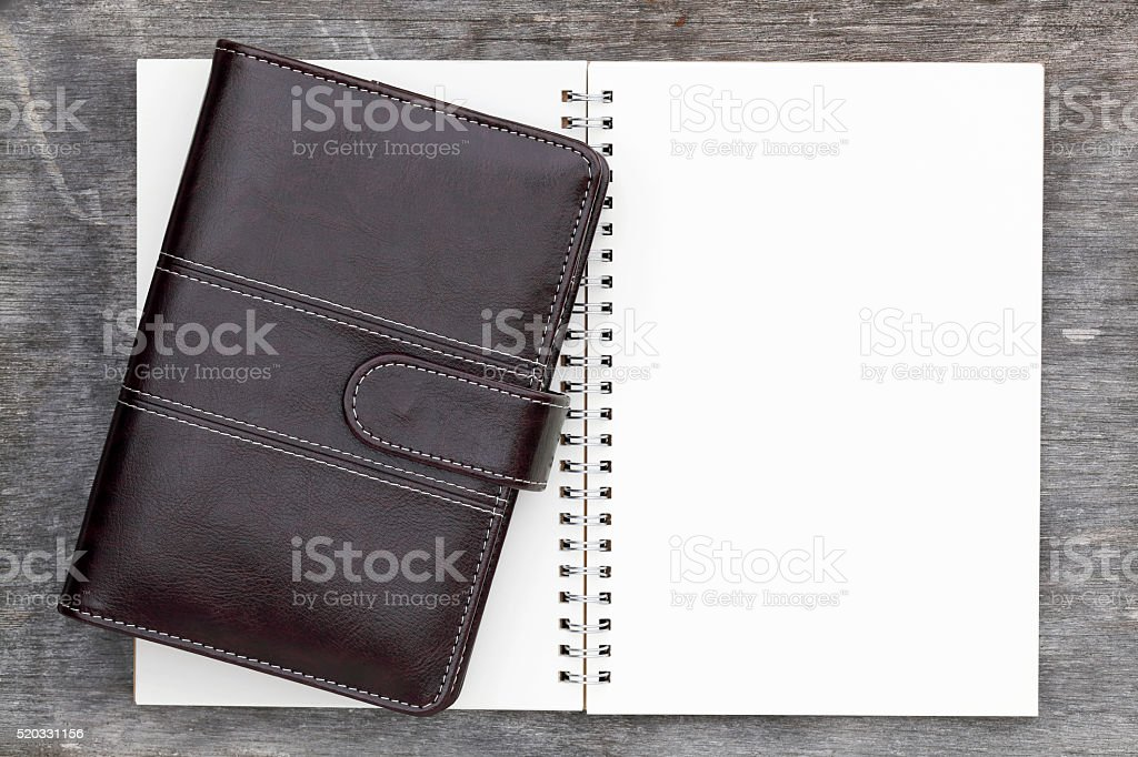 leather notebook and opened spiral notebook stock photo