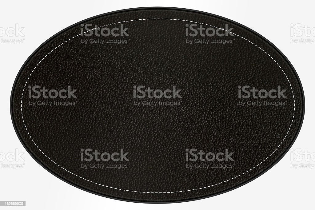 Leather patch, black oval, with border and stitching, clipping path stock photo