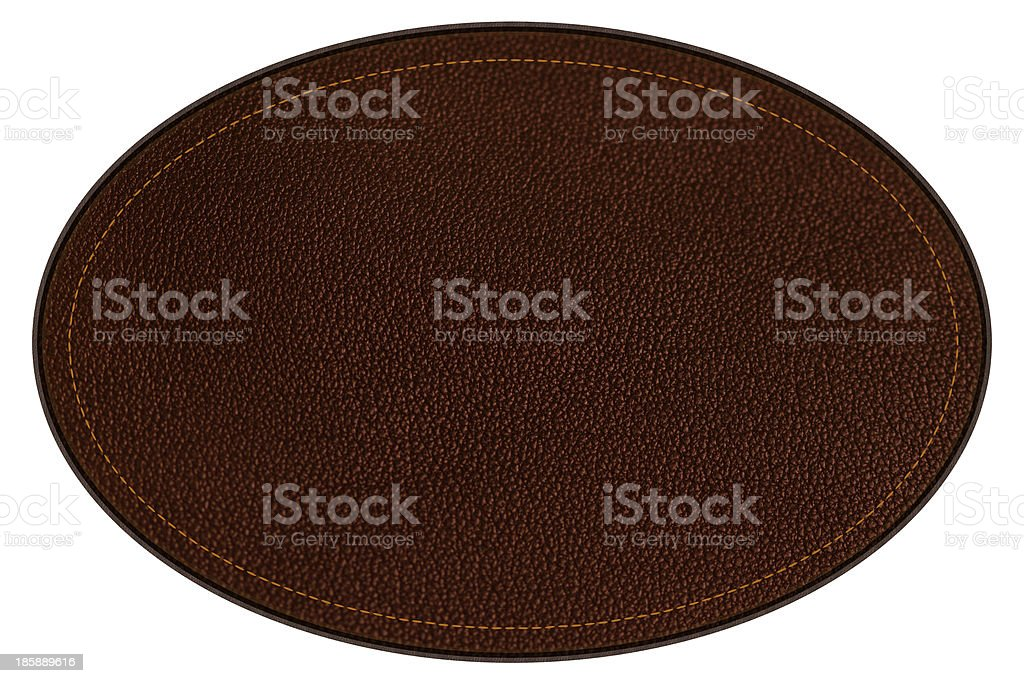 Leather patch, brown oval, with border and stitching, clipping path stock photo