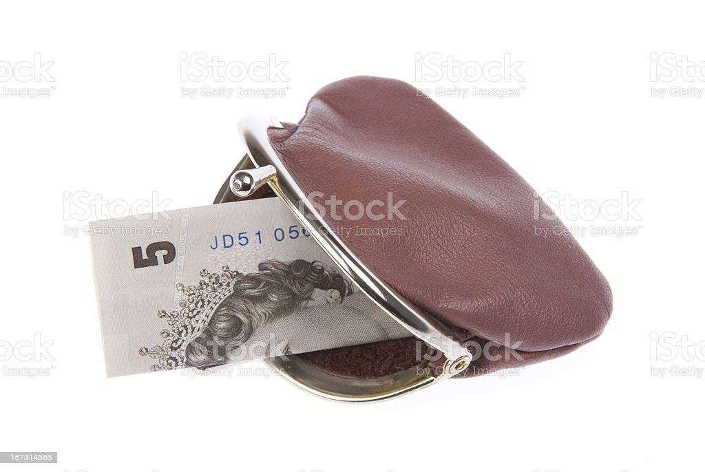 Leather purse with 5 pounds note royalty-free stock photo