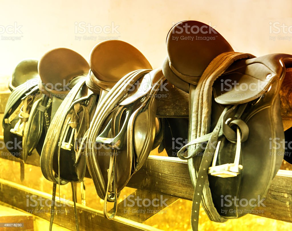 Leather saddles stock photo