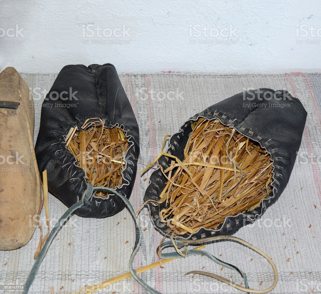 Leather sandals stuffed with hay to maintain the shape stock photo