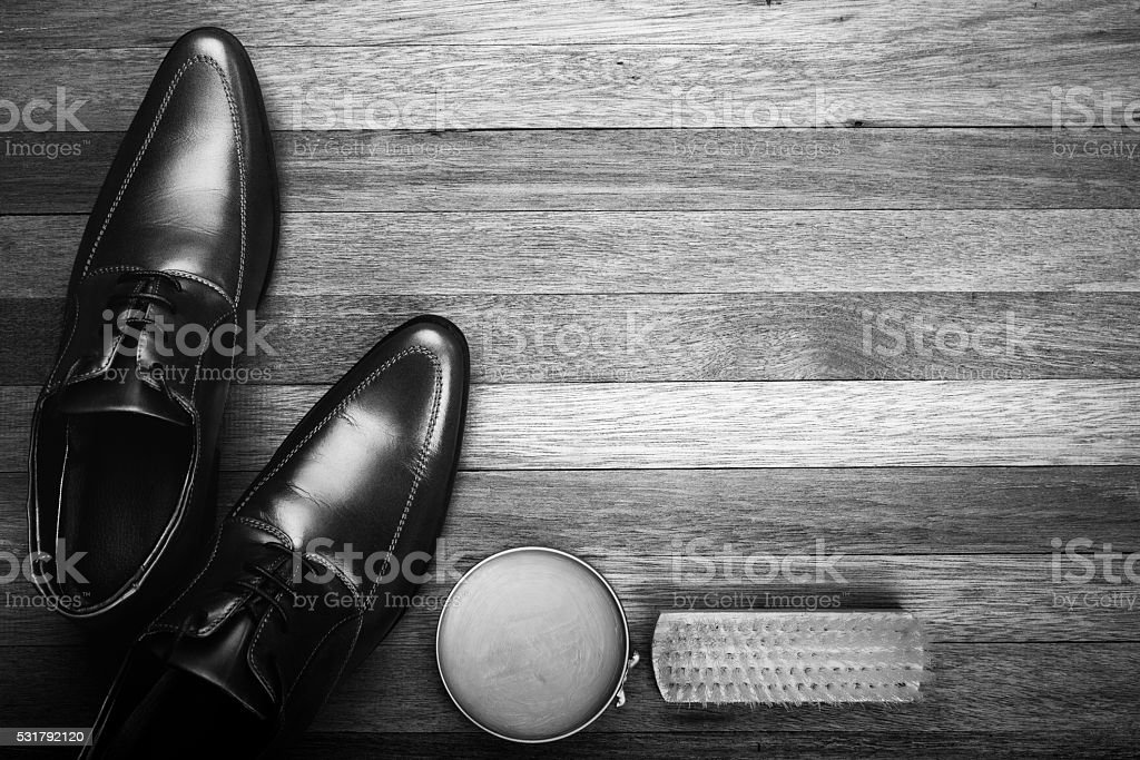 Leather Shoes on Wood Background, Black and White Style stock photo