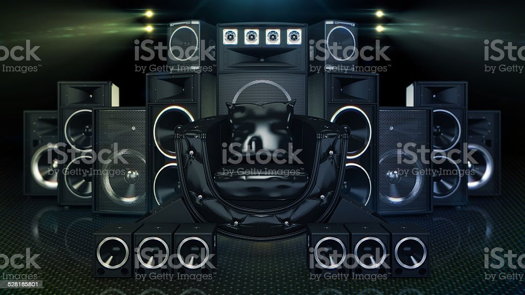 Leather sofa surrounded by speakers stock photo