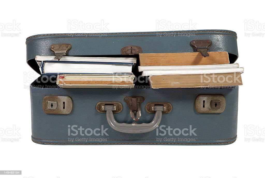 Leather suitcase filled with books on white background stock photo