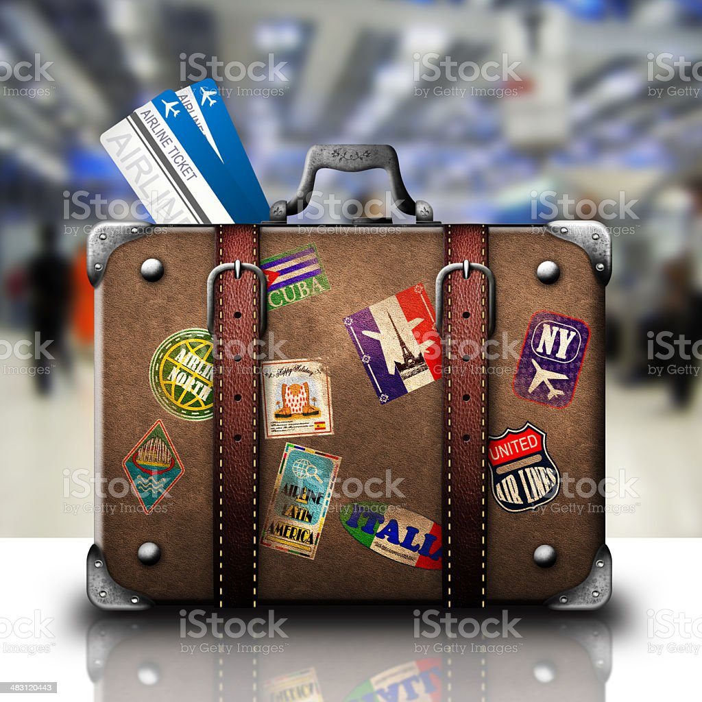 Leather suitcase with tickets and travel stickers stock photo