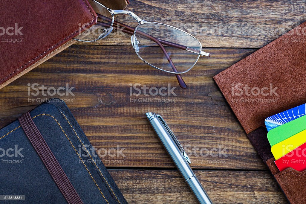 Leather vintage Items on dark Wood Desk Composition stock photo
