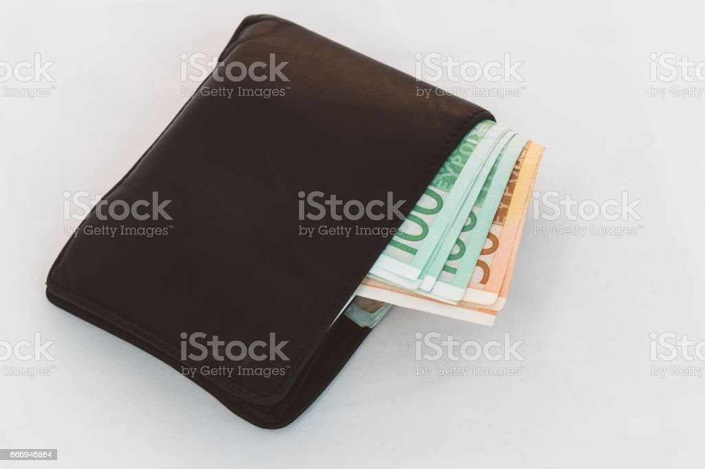 Leather wallet full of cash stock photo
