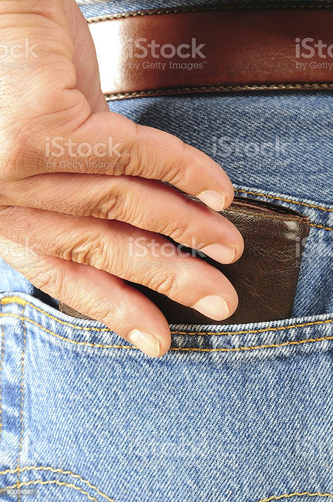 Leather wallet in back pocket. stock photo