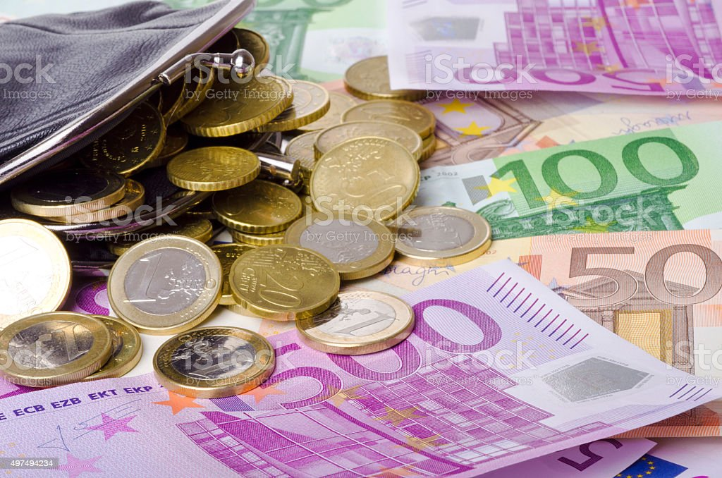 leather wallet with euro banknotes and coins. stock photo