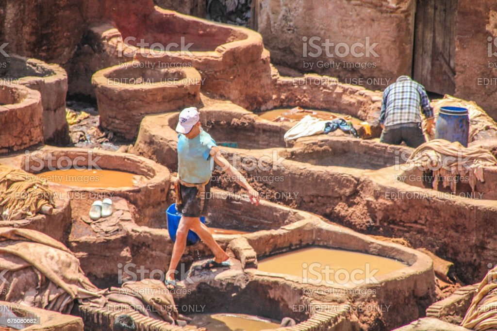 Leather washing on rooftops of Fez stock photo