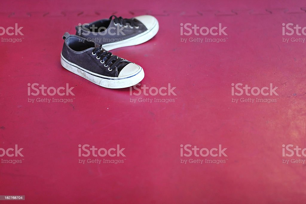 Leave Shoes on a Mat stock photo