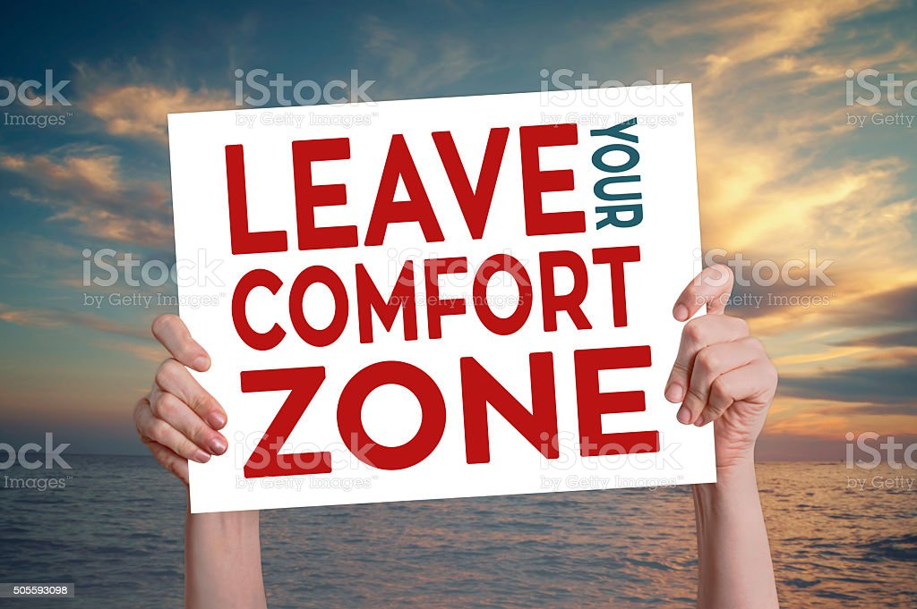 Leave Your Comfort Zone Card with Beach Background stock photo