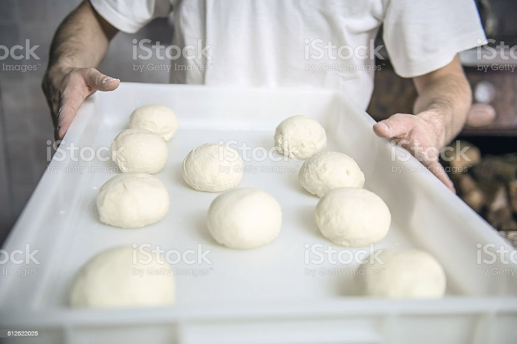Leavened pizza dough ready to be rolled out stock photo