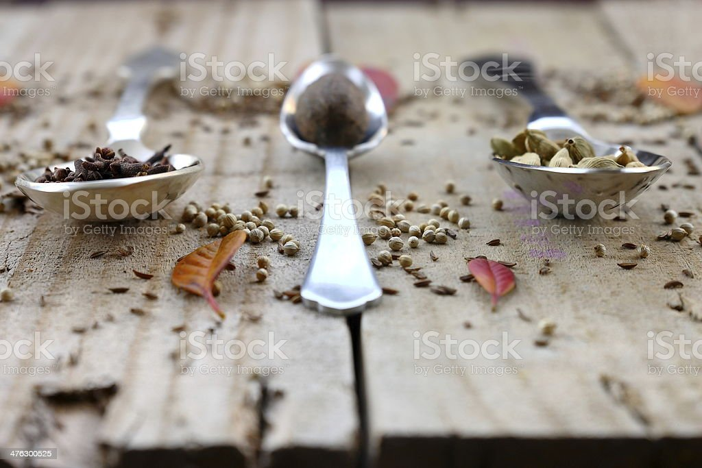 Leaves,spoons and spices stock photo