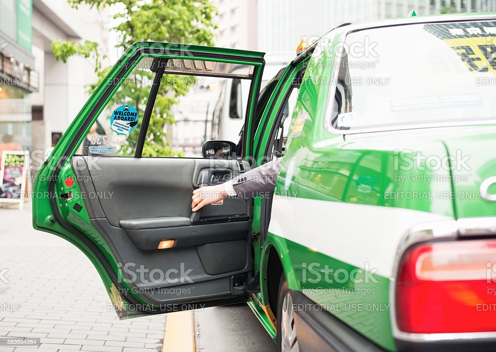 Leaving in a taxi in Tokyo stock photo