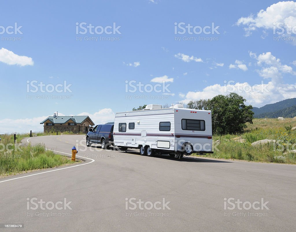 RV leaving mountain campground stock photo