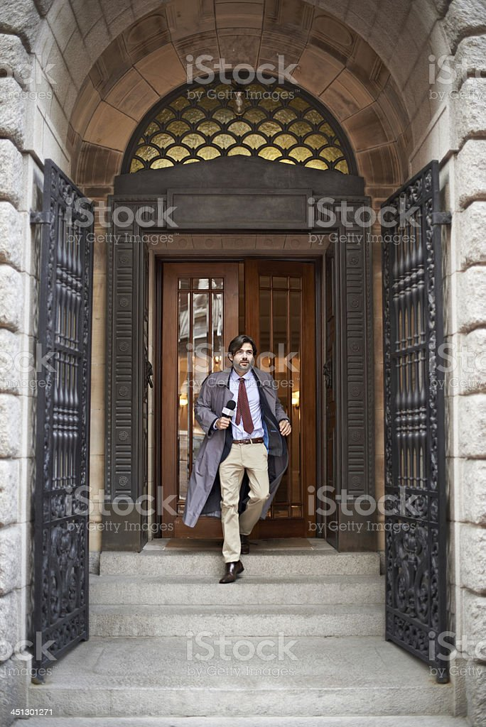 Leaving the office to find his story - Reporters royalty-free stock photo