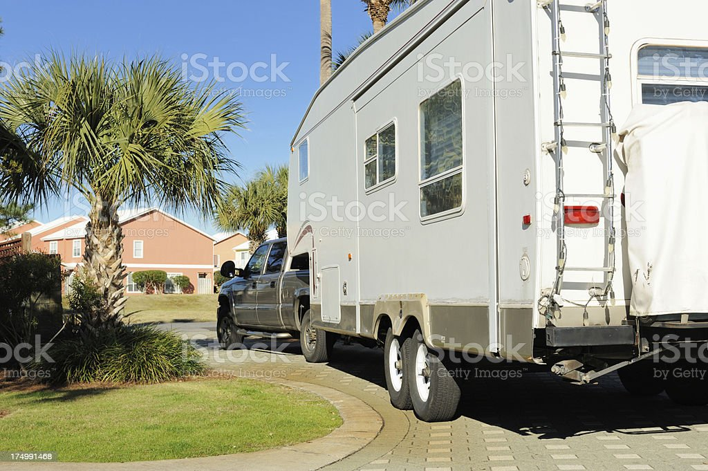 RV leaving through gate royalty-free stock photo
