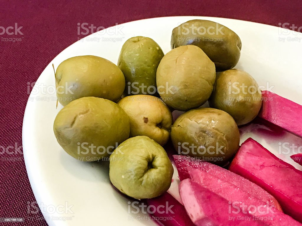 Lebanese olives and pickled turnips stock photo