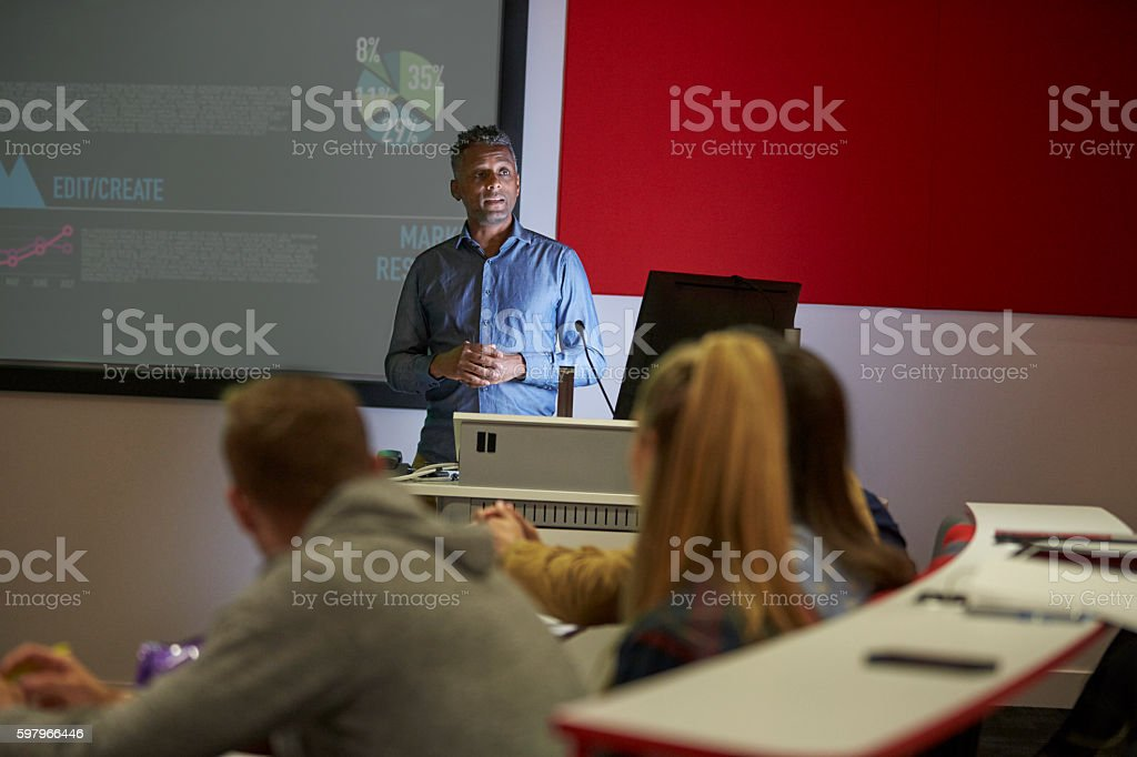 Lecture in a darkened university lecture theatre, student POV stock photo