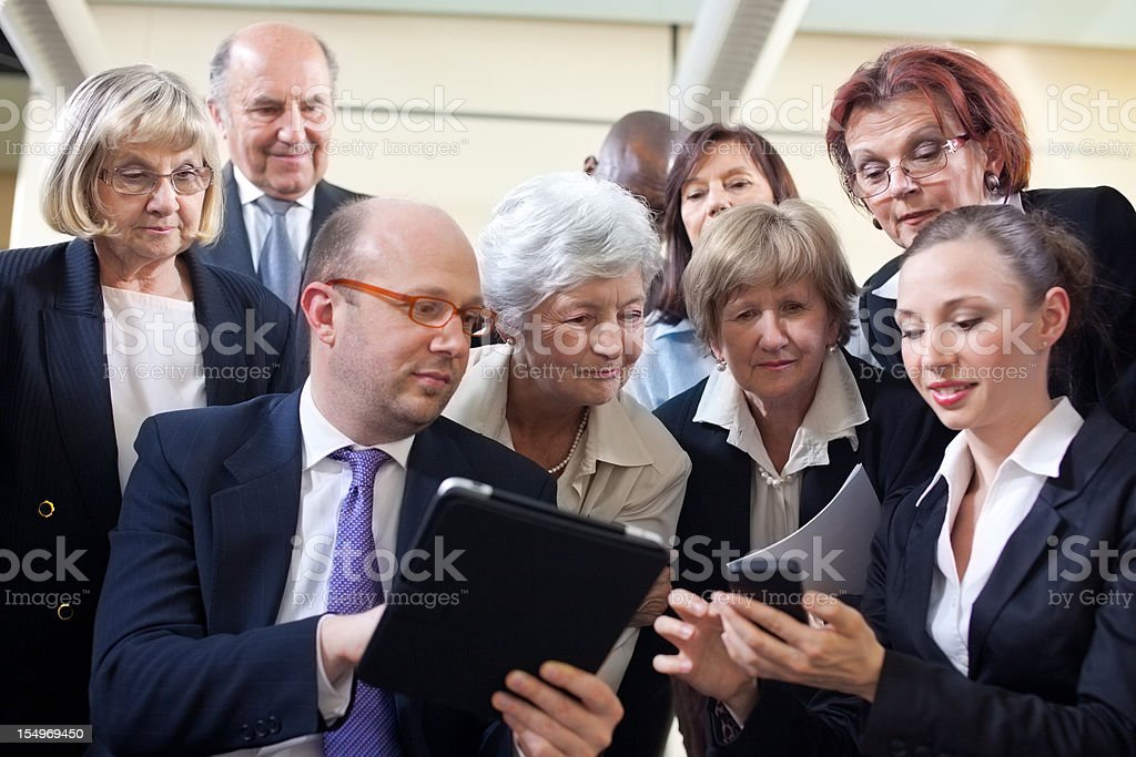 Lecturers showing seniors new technology royalty-free stock photo
