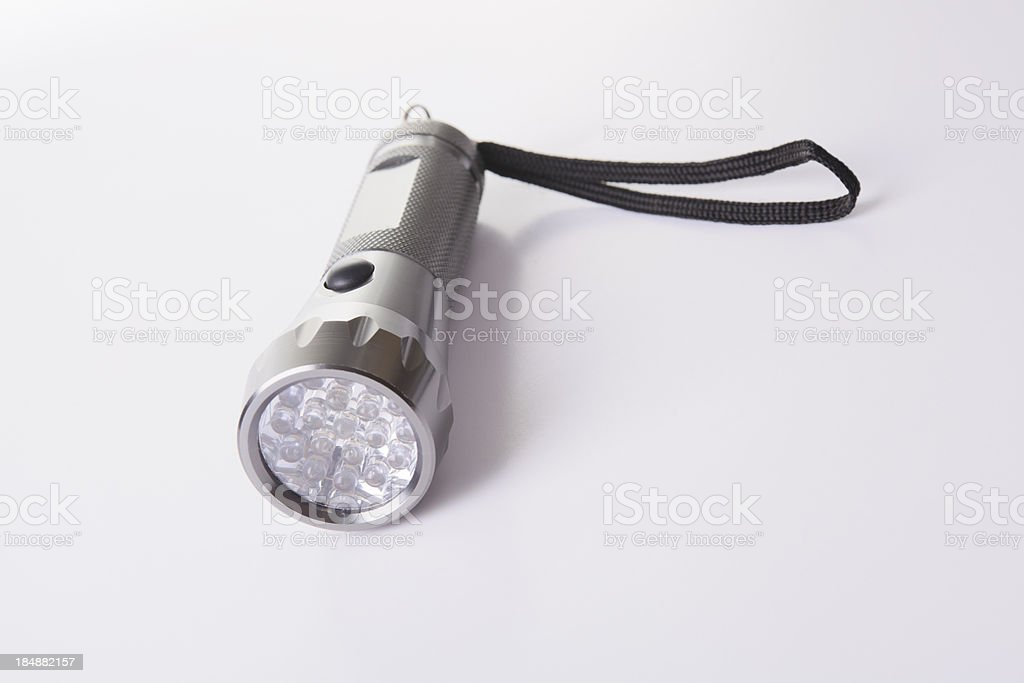 Led Flashlight on Gray Background stock photo
