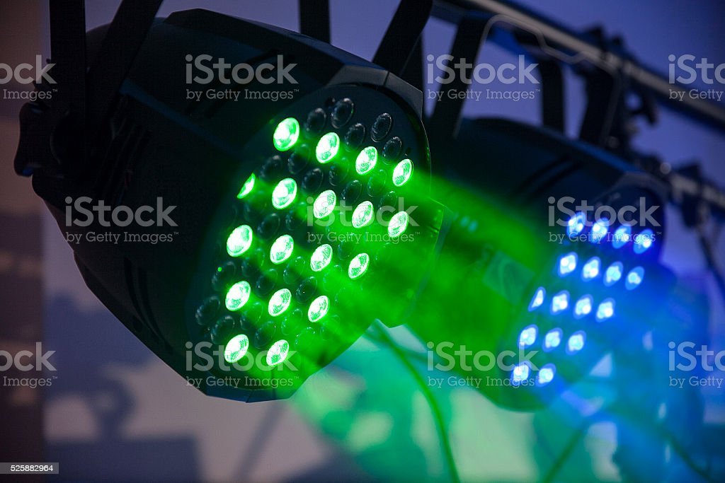 led green and blue concert, naighclub lights with smoke. Closeup stock photo