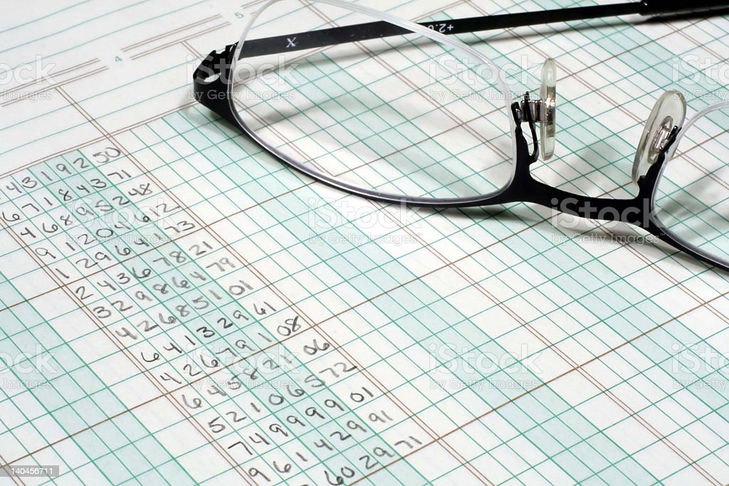 Ledger Paper and Glasses stock photo