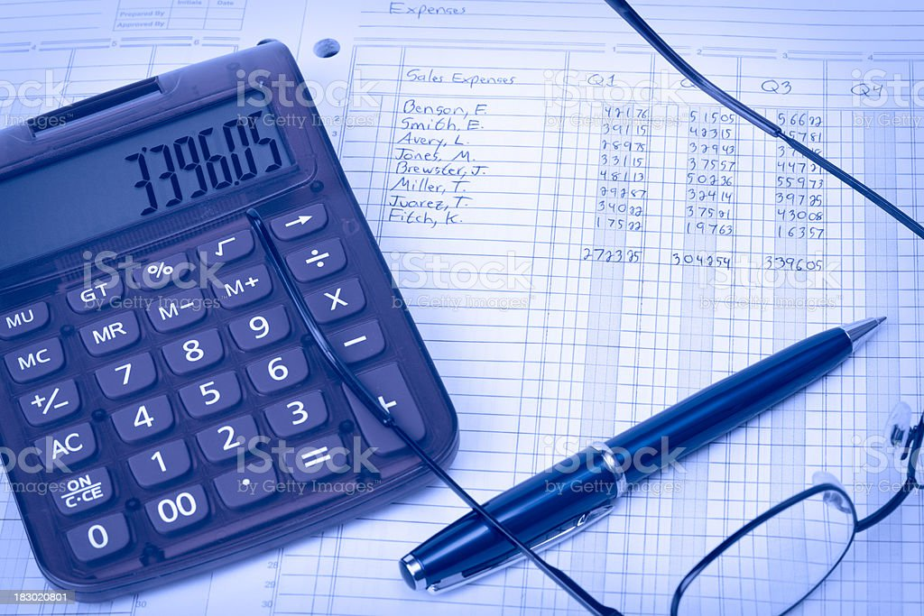 Ledger with calculator, pen and glasses stock photo