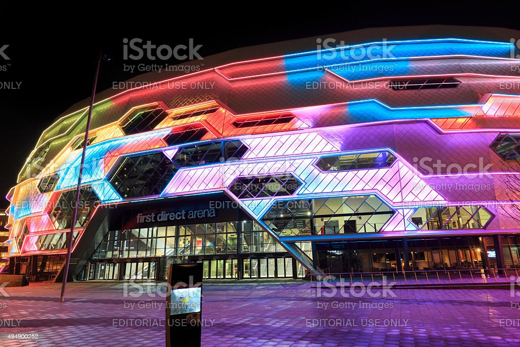 Leeds Arena exterior lit up at night stock photo