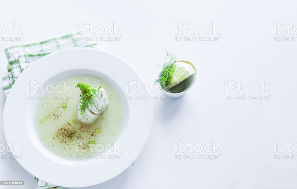 Leek and potato soup with codfish stock photo