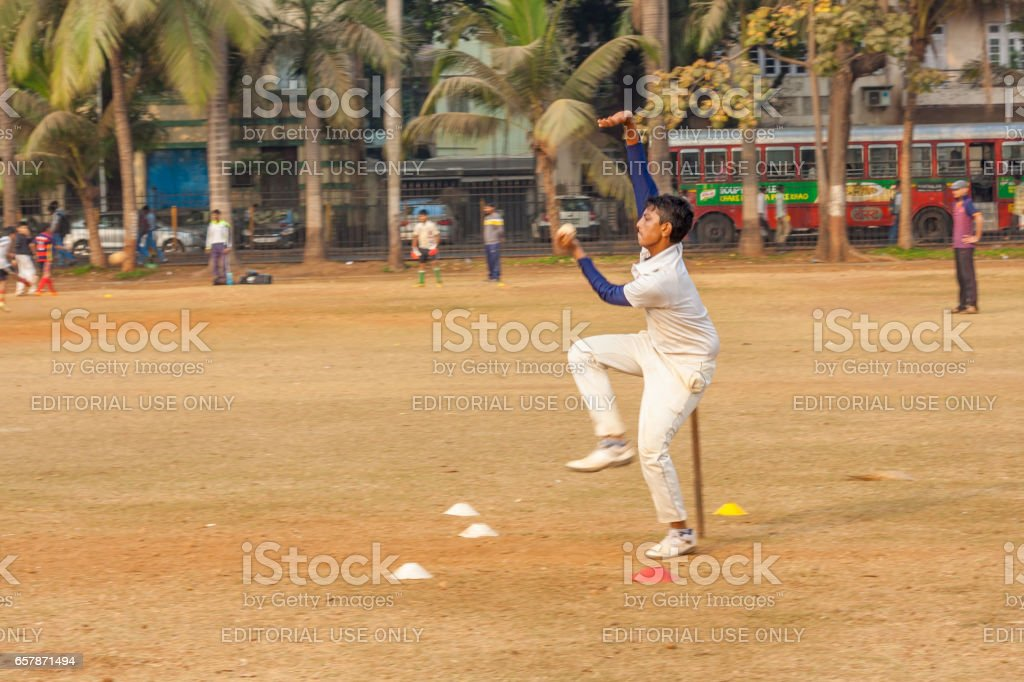 Left arm Spin bowling by a young boy at India stock photo